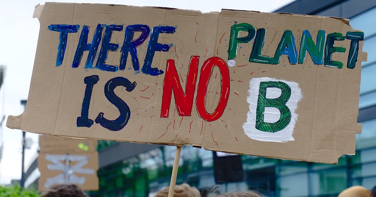 """Climate protest placard reading: """"There is no planet B"""""""
