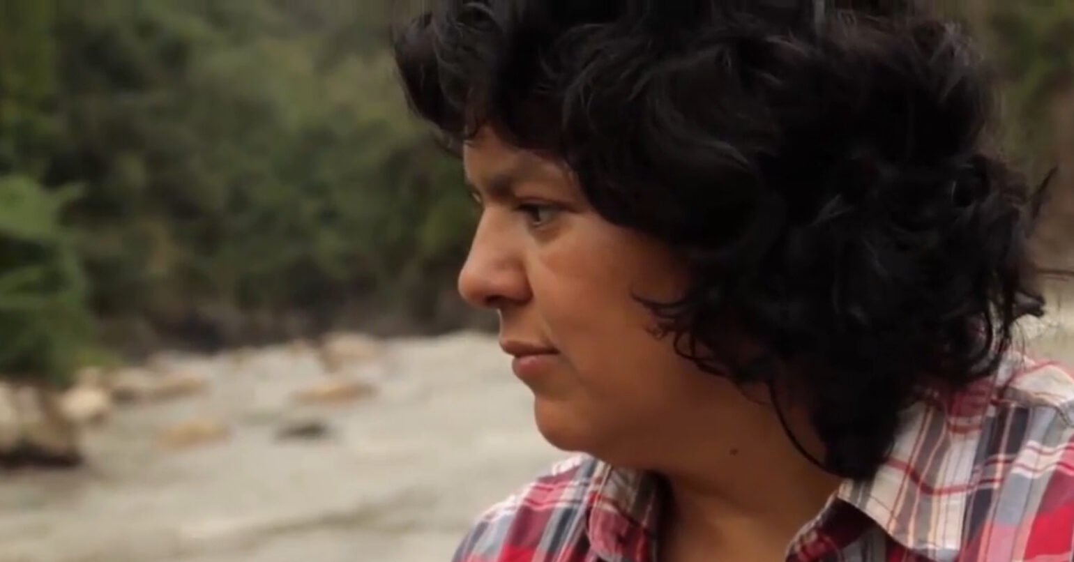 Image of Berta Caceres staring at a river