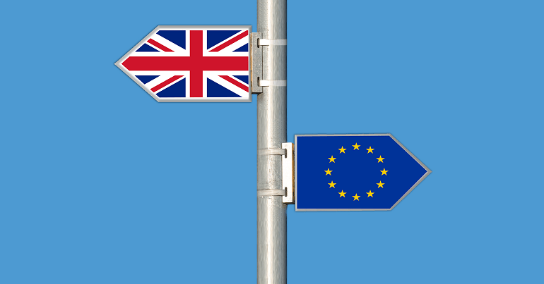 UK and EU flags on a signpost, symbolising Brexit