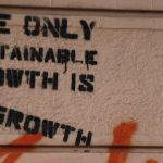 Graffiti which reads the only sustainable growth is degrowth