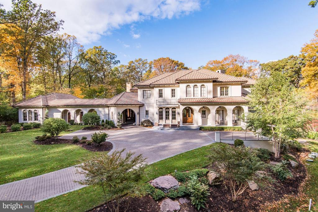 HUGE PRICE REDUCTION!! Custom Mediterranean in prestigious Turkey Run Road. Nestled on +2 acres of professionally landscaped grounds include Pool w/ jets, fire pit, screened in Porch w/ fp, 3-car Garage & Car Port. Interior features 12ft ceilings, hardwood flrs, steam shower, hot air bubble tub, heated flrs, elevator, Sonos inside &out, Main Lvl Master, two-story Great Rm, 2-story Library & state-of-the-art wine cellar.