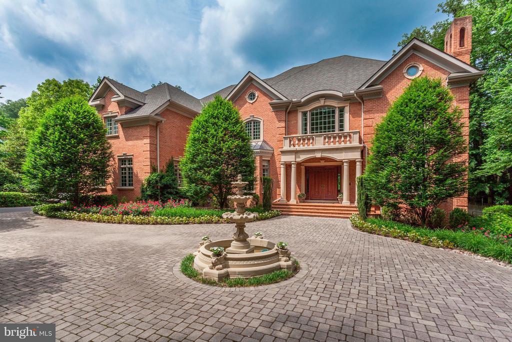 This absolutely stunning Georgian home built in 2006 is located on one acre of land in Langley Forest, a beautiful wooded neighborhood in McLean.  This 12,000 square foot house includes eight bedrooms, seven full and two half bathrooms and three fireplaces on four levels. The main level opens with a dramatic rotunda entry with a curved staircase and an Austrian crystal chandelier and also has a formal living room, a large formal dining room, a cherry-paneled library, and a chef~s kitchen with an adjacent sitting room. On the second level there are six bedroom suites, including the expansive master bedroom suite, which has a romantic dual-sided fireplace, and a sitting area with a hidden coffee nook.  The lower level includes a theatre room, a fitness room, a rec room and an au pair suite. Enjoy the three car garage and the Lutron lighting system. The perfect home for entertaining!