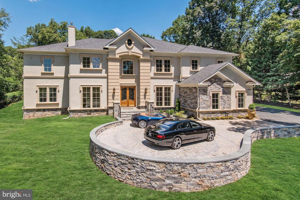 Magnificent custom estate home in Langley Forest, one of the most prestigious neighborhoods in McLean, this magnificent property offers 14,700 square feet of exceptional living space. Elevator service to all 3 levels.  Six bedrooms, including a guest suite on main level, an owner's master suite on upper level with a gorgeous spa-inspired bathroom and secondary en-suite bedrooms