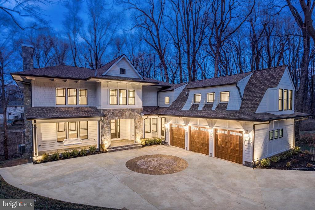 NEW estate home built with exceptional quality & finest materials. 10,500 SF on a cul-de-sac in McLean~s most prestigious Langley Forest neighborhood. Expansive rear and front porch plus 2 level deck. Stunning designer finishes throughout loaded with marble & quartz, Library with 12ft+ceiling. Master with over-the-top luxurious Bath & private Deck. Main Level Bedroom Suite & Above Garage In-Law/Au-Pair Suite.~Chef's Designer Kitchen with Wolf& SubZero Appliances~ Custom built-ins thru-out. Optional Elevator Ready.