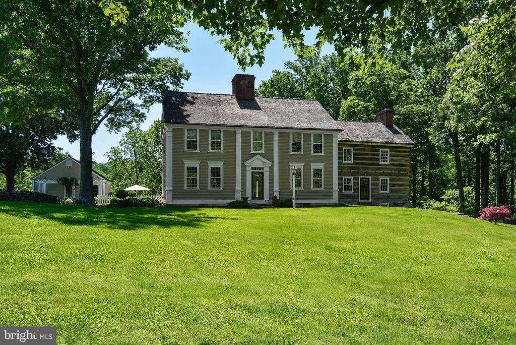 """Mayapple Farm"""", purist delight. Original portion of house built in 1790 in Preston City, CT. House was dismantled and rebuilt at current site. Detail of work is museum quality. Log wing moved to site from western VA circa 1830, 4 BR, 4 full BA, 2 half BA, 9 FP, detached 2-car garage. Historic stone bank barn and log shed moved from Leesburg, VA. Private, minutes from town. Frontage on Goose Creek."""