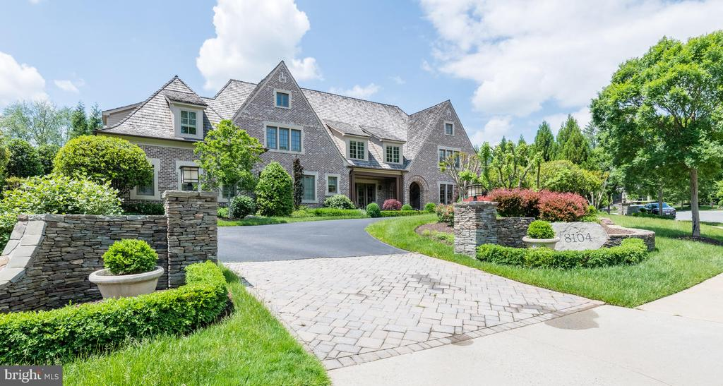 Masterfully-constructed Tudor estate in coveted Spring Hill Farm featuring 5BR/5FB/3HB, 3 fireplaces, gourmet kitchen, spacious lower level with a home theater and large rec room, 3-car garage, and a covered porch leading to the pool and whimsical backyard.