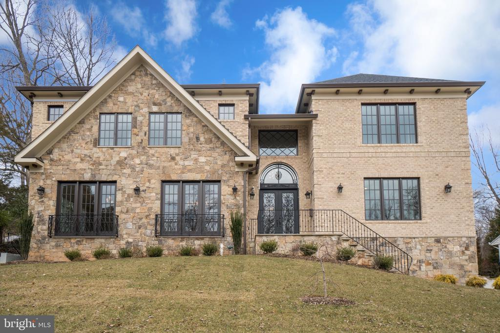 Open House Sunday, 2-4PM.   Elegant New stone and brick construction in quiet st in Salona Village.   Entering the stunning foyer, you are immediately impressed with the stunning finishes.  The handcrafted iron railings set apart the spaces along with premium light fixtures.   The gorgeous hardwood floors highlight a floor plan that is unique and open, providing the perfect setting for comfortable living as well as grand entertaining.  Coffered ceilings and mood lighting are coupled with the finest of millwork.  The gourmet kitchen is stunning, with top of the line appliances including a large center island.  The home features 6 en-suite bedrooms and 6.5 baths.  The master suite has a double-sided fireplace and is a show-stopper with a master bath and master closet that are nothing short of amazing.  The lower level has a beautiful bar, wine cellar, fitness room/theater.  The home features extensive video security.  Saturn Partnership has delivered a home that is nothing short of amazing in every way.