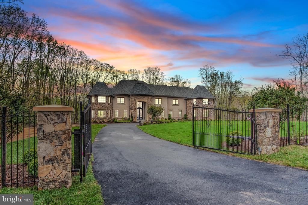"""Fabulously set on nearly 3 gated acres in McLean's Peacock Station neighborhood rests this like-new mansion offering top-quality construction & materials. With over 13,000 finished square feet on the three elevator- serviced levels, our features include: dramatic open floor-plan on the main level, massive main kitchen with seperate caterer's kitchen, sumptuous owner's suite with """"must-see"""" extensively built-out closets and luxury bath, a true entertainer's lower-level with large bar, dry & steam saunas, cinema, game rooms and more. Garage parking with 4-bays and an amazing expansive deck overlooking the rear grounds large enough for a potential pool."""