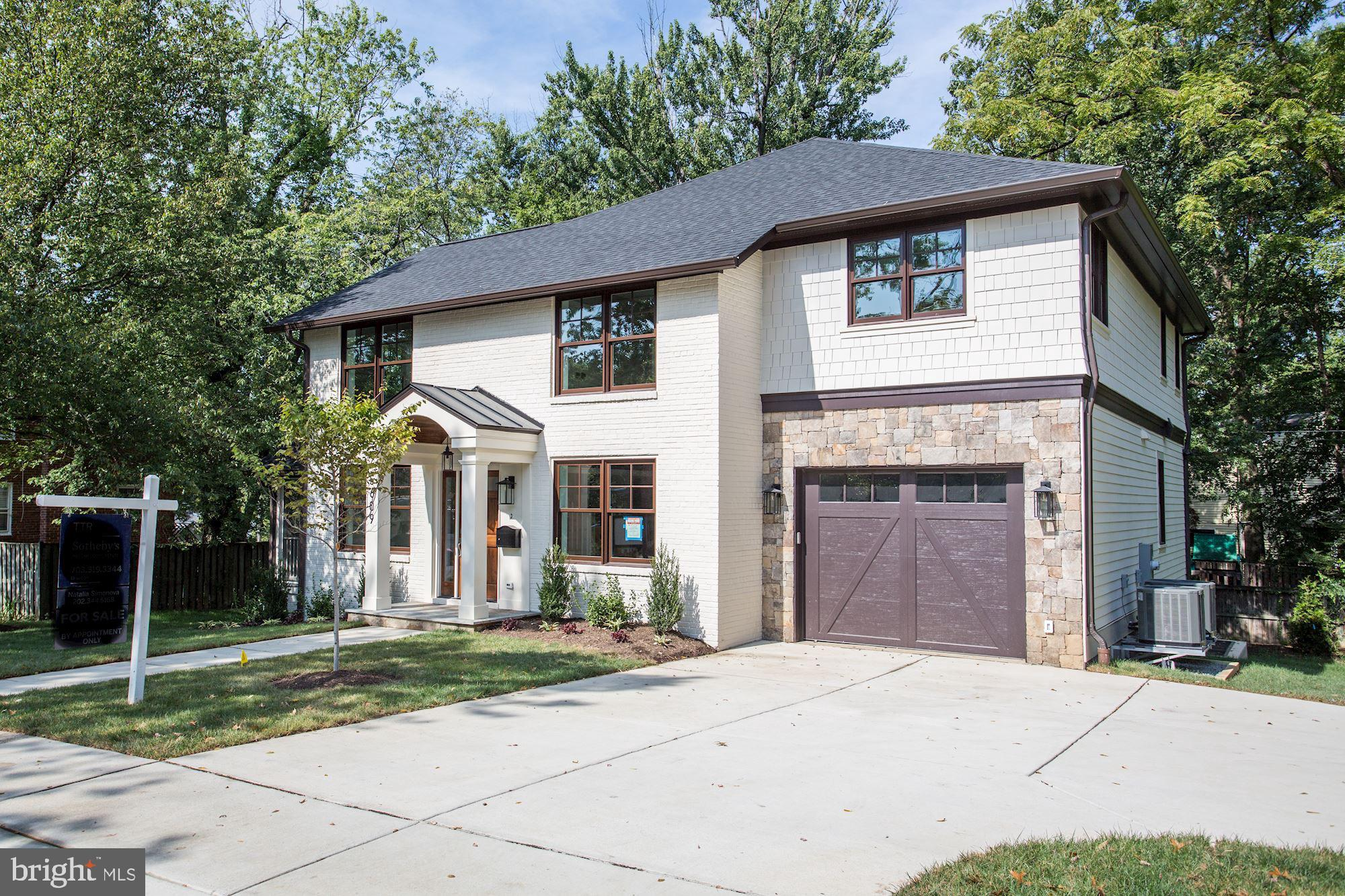 Welcome to this Just completed Craftsman home on a large lot in sought after North Arlington. This 5 Bedrooms, 4 full and 1 half Bathrooms, 1 car garage, approximately 4500 square feet has high end finishes throughout.  Gourmet chef's kitchen with Wolf and Subzero appliances and waterfall edge island opened to a bright family room with modern fireplace. Separate living room and dining room with butler~s pantry.Master bedroom suite with two walk in closets featuring spa like en-suite with luxurious soaking tub, double vanities and radiant floor heating. Hardwood floor throughout the house, screened -in porch of living room.