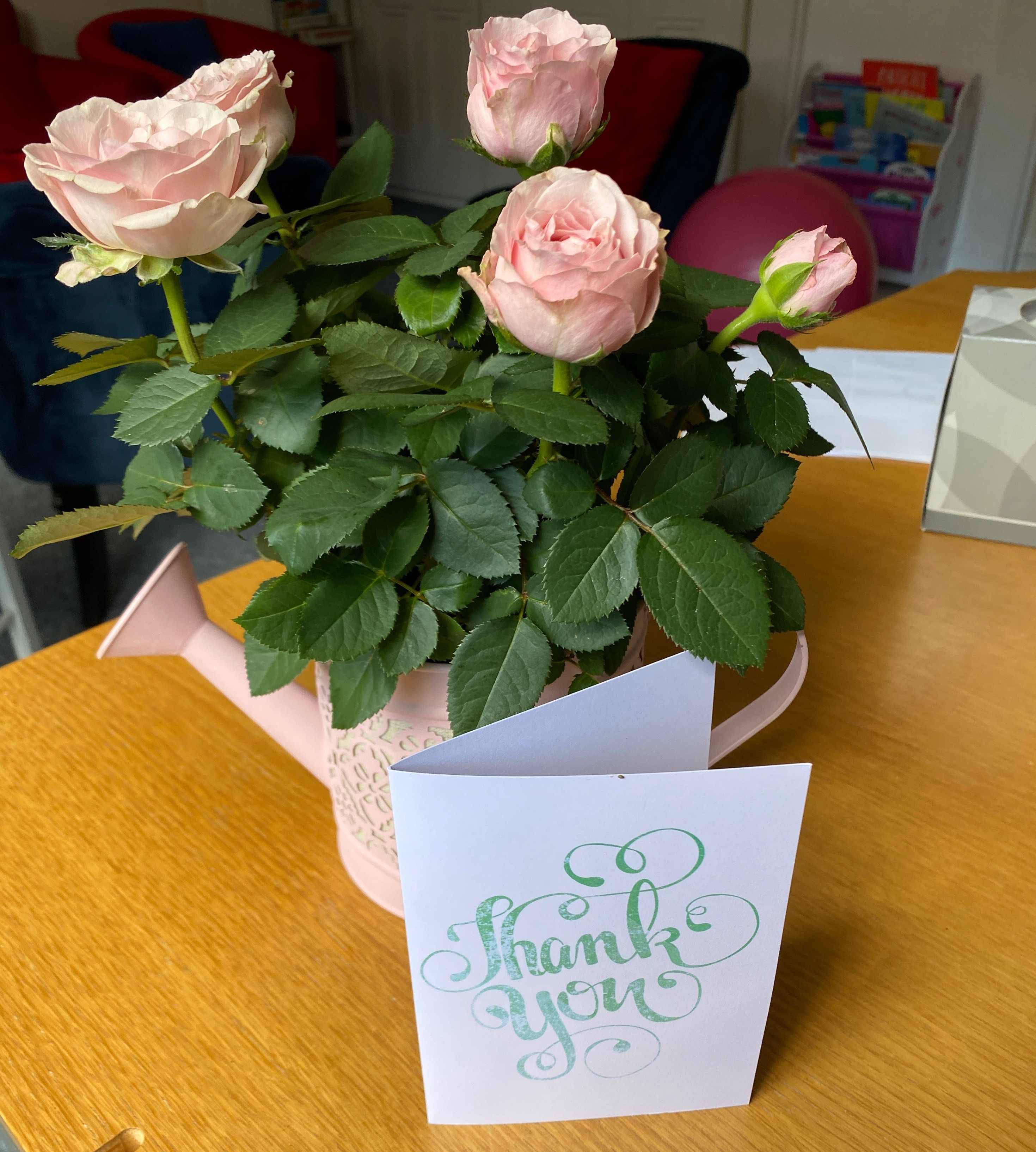 CBT case studies - flowers and card from happy client