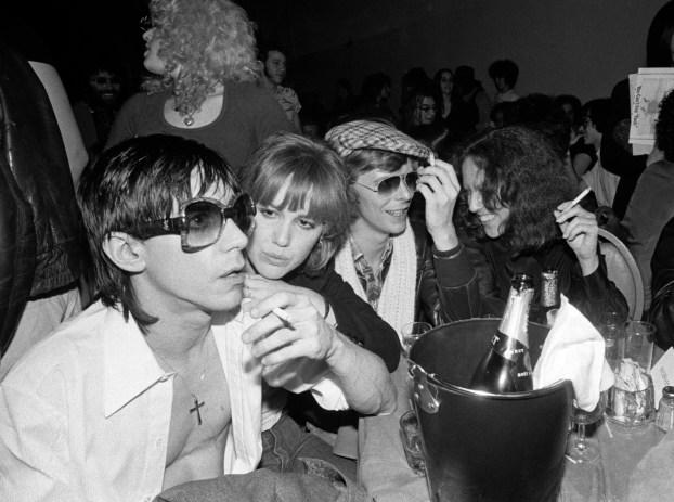 Lisa, Iggy, Cyrinda Fox, David Bowie at Ocean Club.1977.creditBobGruen