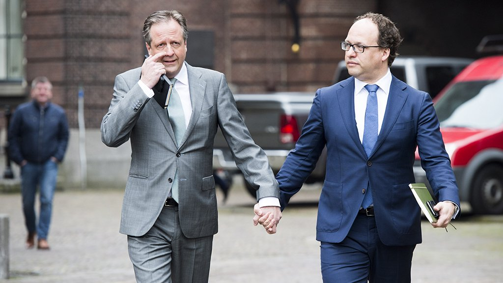 Two male Dutch politicians hold hands to support LGBT community