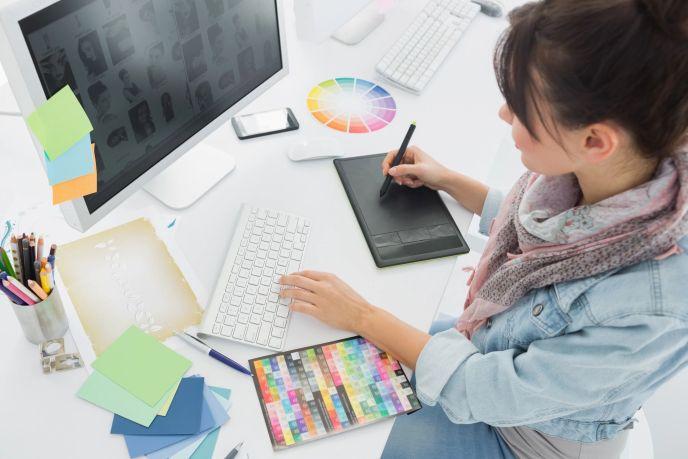 graphic designer creating something at her desk