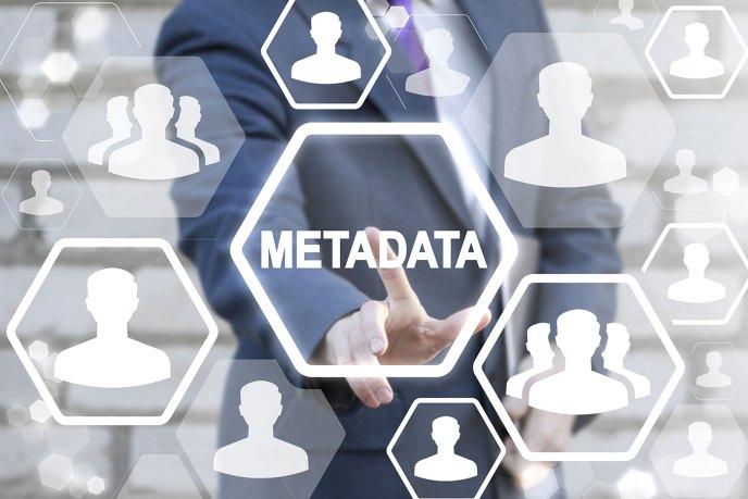 business man touching the word metadata