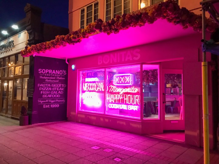 The pink neon lights in the shop window of Bonita's Taco Restaurant in Southsea