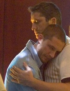 Tom Hardy as Handsome Bob, dancing with Gerard Butler in RocknRolla