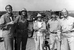 A diminutive Dwan (center) on the set of Sands of Iwo Jima. Note John Wayne to his right.