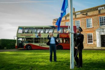 Crime Commisioner Katy Bourne & Chief Constable Richards raise the White Ribbon flag at Sussex police HQ. Credit: @sussex_police