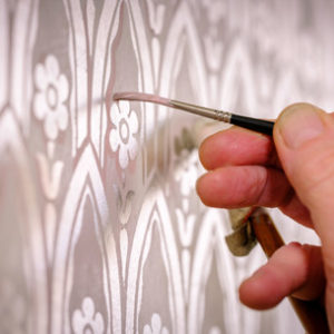 Platinum motif being applied by hand
