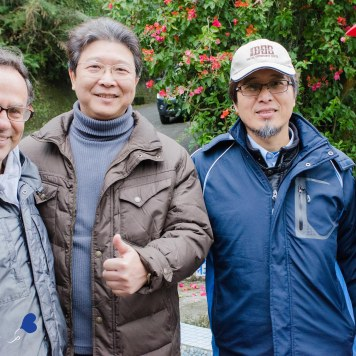 Father Barry Martinson and Principal Chen and Patawang Iban from the Taoshan Elementary School