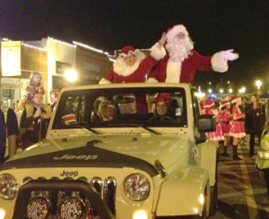 Santa arrives in a Jeep