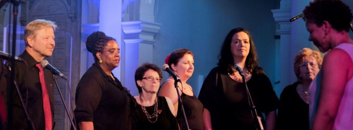 Members of Bright Soul choir singing at a concert