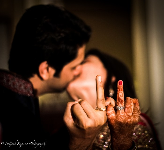 MARRIED COUPLE SHOEING THEIR WEDDING RINGS CLICKED BY BRIJESH KAPOOR PHOTOGRAPHY