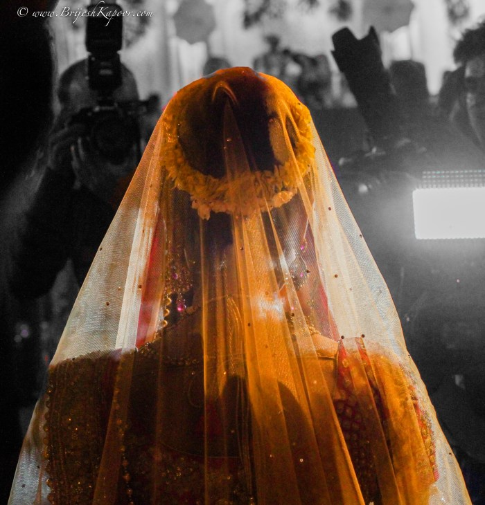WEDDING PHOTOGRAPHY SHOT BY BRIJESH KAPOOR OF AN INDIAN BRIDE BEING CLICKED BY THE PAPARAZZI BEFORE HER MARRIAGE CEREMONY