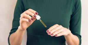 woman-applying-argan-oil-to-her-nails