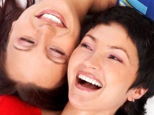 two women friends laughing