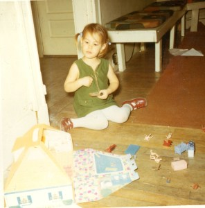 Maxima age 3 with dollhouse