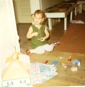 Maxima age 3 with dollhouse