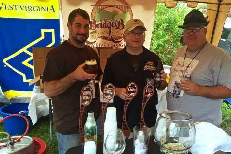 Bridge Brew Works co-owners/brewers Nate Herrold (left), Ken Linch (center) racked up a bounty of medals at the 2015 Bramwell Oktoberfest.