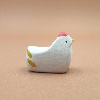 Poule blanche couché