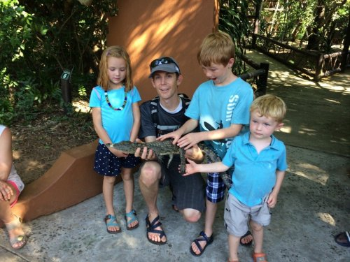 kids holding crocodile