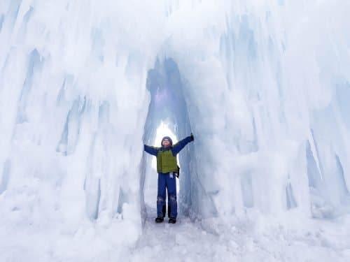 kid touching ice castles
