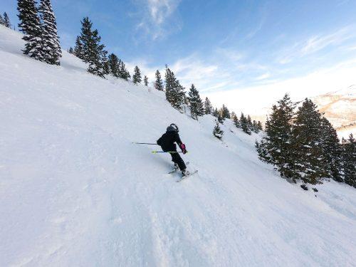 girl skiing steep terrain