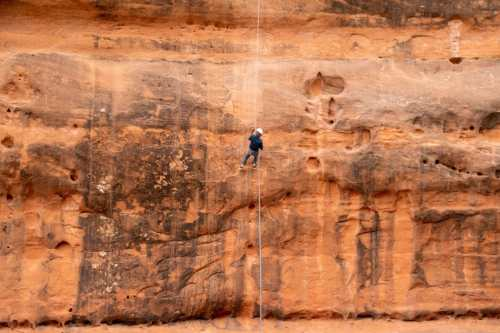 boy canyoneering rapelling in moab