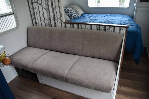 reupholstered RV sofa with access panel