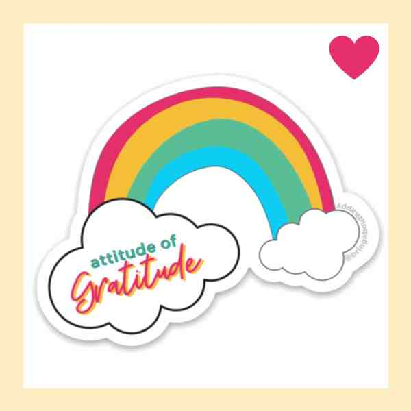 Rainbow with clouds and attitude of gratitude written on one of them