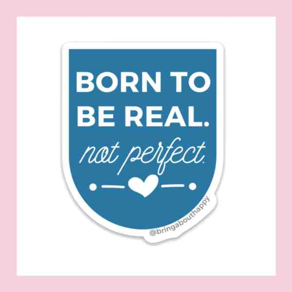 Born to Be Real Not Perfect write in white on a blue pendant sticker