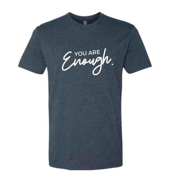 A shirt in indigo blue with You Are Enough written in white text