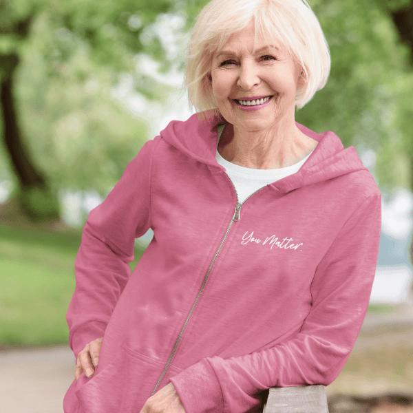 A woman wearing a rosy mauve you matter zip hoodie sweatshirt Bend, Oregon