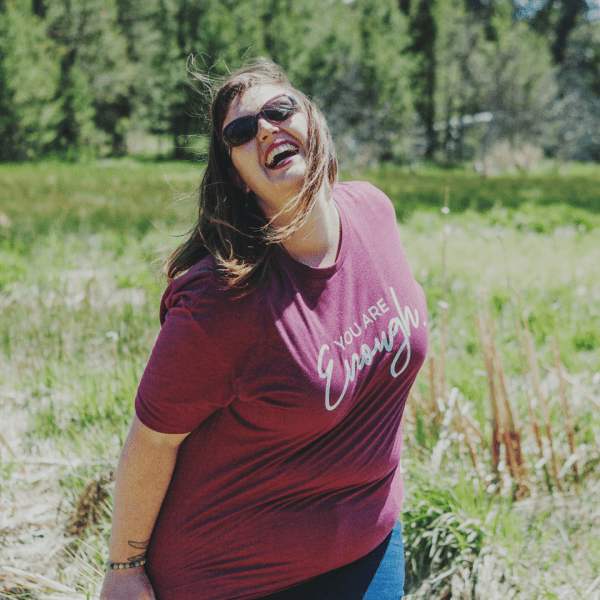 A woman standing in a field wearing a You Are Enough Classic Fit Sangria Maroon