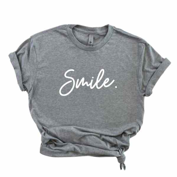 Heather gray shirt with smile written in white cursive font