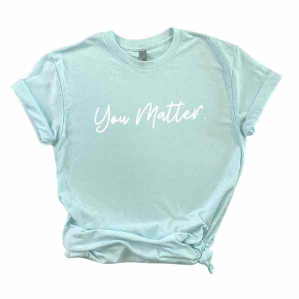 Light blue tshirt with you matter written in white cursive font