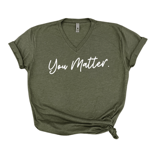 Solid white background with military green v neck that says you matter in white text