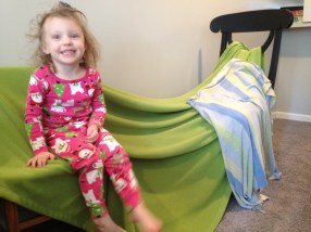 Fun chair/blanket fort. See that leg swinging? Always in motion.