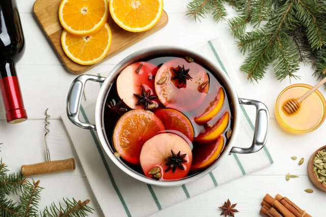 Mulled Wine being made in a large saucepan filled with fruit