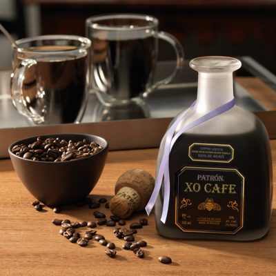 Patron Coffee Liqueur Next to a bowl of coffee beans
